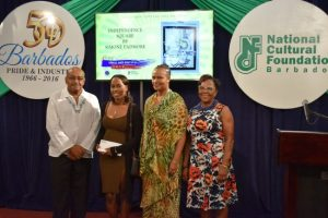 From left, Cranston Browne CEO of the NCF, Governor's Award winner Simone Padmore, Celeste Wood of the Barbados Central Bank and NCF chairman Maureen Graham.