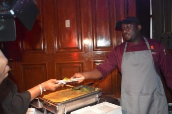 Chef Creig Greenidge serving a patron at Rum & Rhythm.