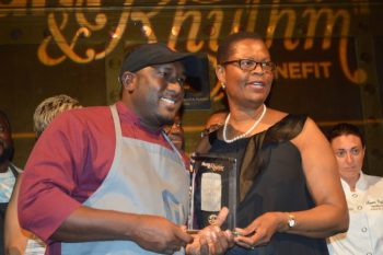 Chef Creig Greenidge receiving his Chef Of The Year Award from CTO's United States director Sylma Brown-Bramble.