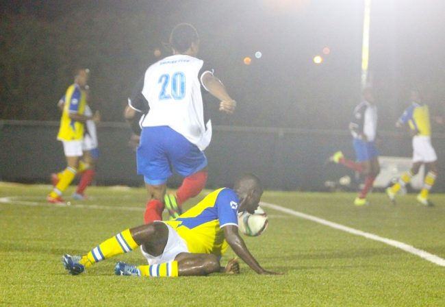 Empire striker Ormando McLeod scored a hat-trick and one of them came when he dribbled past Paul Lovell of Rendezvous.  (Pictures by Morissa Lindsay).
