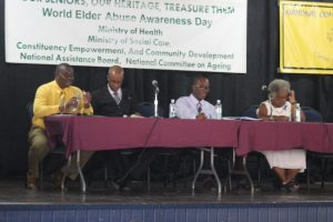 RBPF Inspector Stephen Griffith (left), gives his views on elderly abuse, while attorney-at-law Steve Gollop (second from left), Reverend Clayton Springer (second from right) and retired psychiatrist Dr Ermine Belle (right) listen attentively.