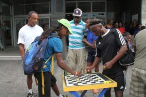 A friendly game of Draughts in the city.