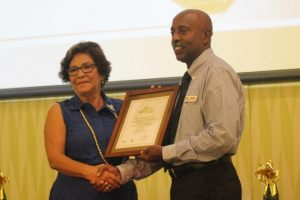 Massy Stores was recognized for being exemplary in employing people with disabilities. Here, Charles Lynch of Massy (Barbados) collecting the award from managing director of Caribbean Catalyst, Rosalind Jackson.