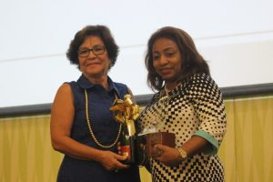 Managing director of Caribbean Catalyst, Rosalind Jackson, presenting director of human resources at the Hilton Barbados, Cheryl Corbin, with the BBE Award in the large company category.