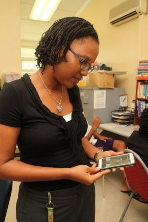 A'ja Maxwell looking at a photo of the late Eucalene McConney.