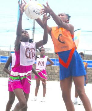 Most outstanding goal-defender Amariah Wiliams of St Giles Primary (l) clashes with Vauxhall Primary's center Joanna Atkins for ball possession.