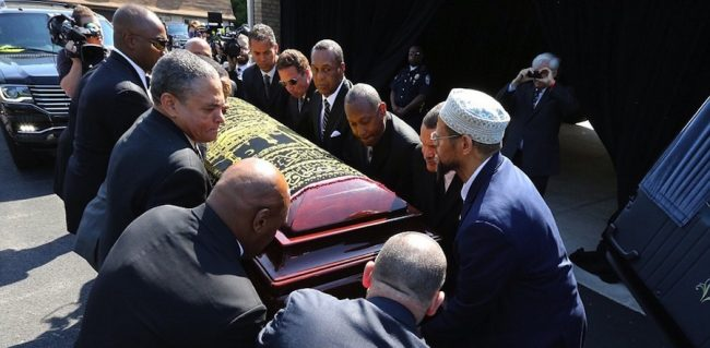 Pallbearers that included Will Smith, Lennox Lewis and Mike Tyson lifting Muhammad Ali's casket into the hearse. (Picture compliments the Daily Mail).