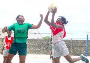 St Giles Primary's goal-attack Serena Edwards shot one past St Winifred's  goal-defence Jenascia King.