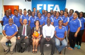 Participants of the Women's Football Development FIFA Administration Course along with FIFA representative Ebru Koksal (center) and members of the BFA executive (from left) Neil Mathews, chairman of the BFA technical committee, Adrian Donovan, general secretary Edwyn Wood and chairwoman of the BFA Women's Committee, Nicole Puckerin. (Picture by Morissa Lindsay)