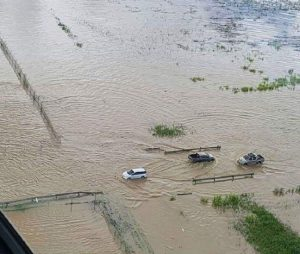 An aerial view shows vehicles trying to navigate the flooded roadway in Piarco on Friday.
