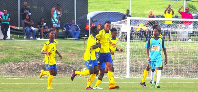 Barbados cptain Kaeson Trench (third left) is all smiles after scoring the goal that would eventually lead his team to a 2-1 win over St Lucia. (Pictures by Morissa Lindsay).