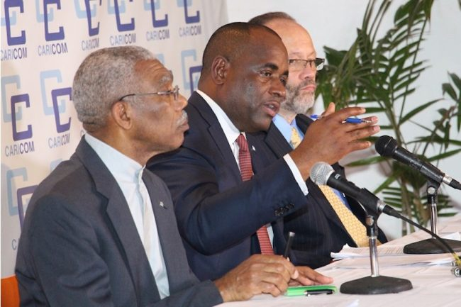 Chairman of the Community and Prime Minister of Dominica Roosevelt Skerrit (centre), flanked by President  of Guyana David Granger (left) and the CARICOM Secretary-General, Ambassador Irwin LaRocque (right).