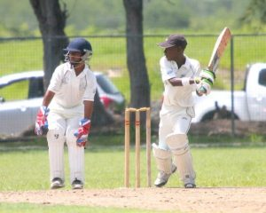 Corey Hoyte smashes a four through backward point during his knock of 60 for Grantley Adams Memorial.