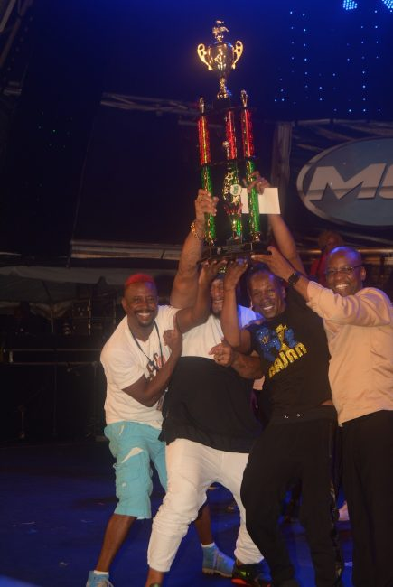 Lil Rick (centre), celebrating his win with Mr. Blood (left), who placed second; Peter Ram (second from left), who placed third and Minister of Culture Stephen Lashley (right).