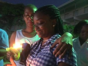 During tonight's vigil, Rianndo's  best friend Destinee (right) was overcome with tears.