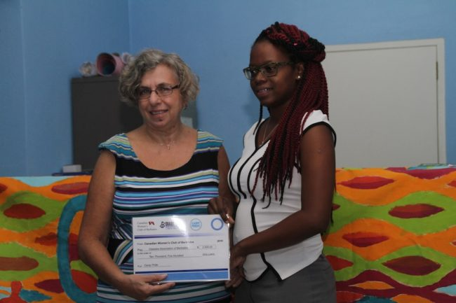 Left, President of The Canadian Women's Club of Barbados Beverly McCollin-Moore presenting nutritionist Nicole Griffith with a cheque.