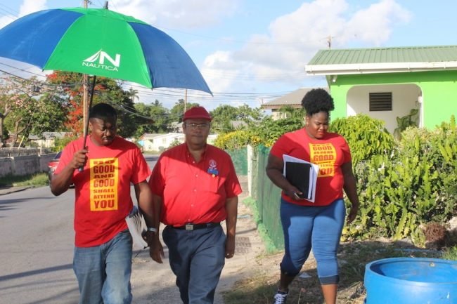 Dr William Duguid (centre) during Sunday's canvas in the Christ Church West constituency.