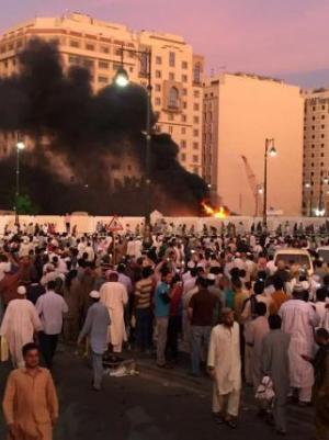 Muslim worshippers gather after a suicide bomber detonated a device near the security headquarters of the Prophet's Mosque in Medina, Saudi Arabia, Monday.