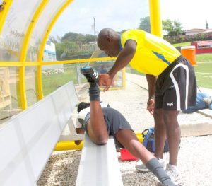 Physical trainer Leroy Stuart attends to one of the players. (Pictures by Morissa Lindsay)