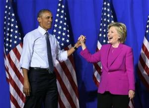 President Barack Obama and Democratic presidential candidate Hillary Clinton arrive at a campaign event at the Charlotte Convention Centre in Charlotte, North Carolina, Tuesday.