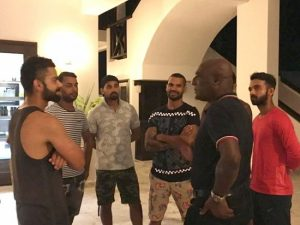 Sir Vivian Richards (second right) talking with members of the Indian team ahead of Thursday's Test match. Indian captain Virat Kohli is at left.