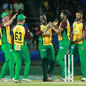 Sohail Tanvir (second right) celebrating one of his four wickets.
