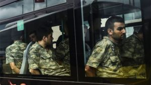 Soldiers detained for suspected coup involvement are brought to court in Istanbul.