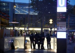 Special force police officers stand guard at an entrance of the main train station, following a shooting rampage at the Olympia shopping mall in Munich, Germany, on Friday.