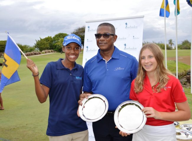 Barbadian Emily Odwin (left) and Brooke Rivers of Turks & Caicos tied for first place in the girls' 13 and under division and were presented with their awards by Trevor Tasker, president of the Barbados Golf Association.