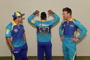 (From left) Robin Singh, Nicholas Pooran and AB de Villiers show off the Rock Hard Cement logo.