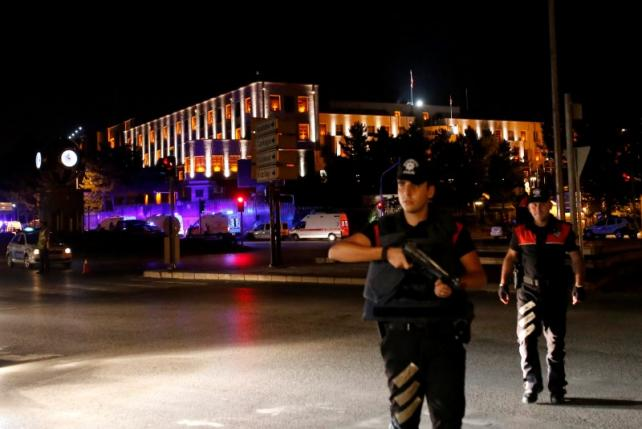 Police officers stand guard near the Turkish military headquarters in Ankara, Turkey, July 15, 2016. REUTERS/Tumay Berkin