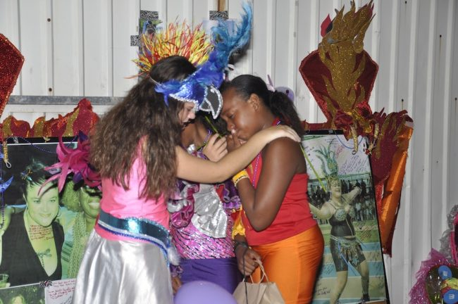 Grieving young masqueraders turned to each other for comfort.