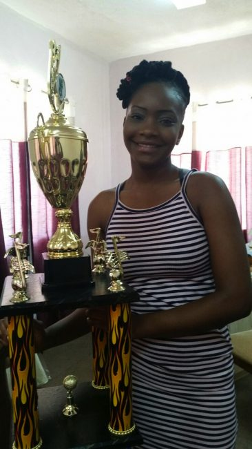 Queen Aziza shows her trophy.
