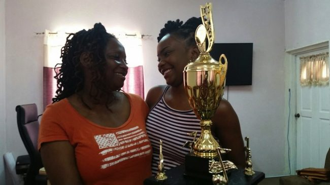 Calypso Queen Aziza Clarke (right) and her mother Carol celebrating the young woman's victory.