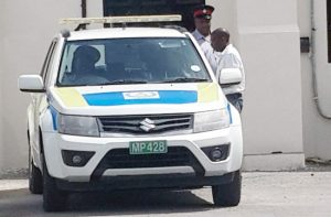 Prison officer Shawn McDonald Herbert leaving the District 'C' Magistrates' Court Friday.
