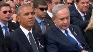 A still image taken from a video shows Israel's Prime Minister Benjamin Netanyahu and U.S. President Barack Obama attending the funeral of former Israeli President Shimon Peres in Jerusalem September 30, 2016. REUTERS/Pool via Reuters TV