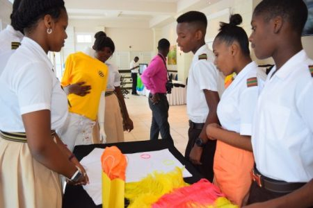 Christ Church Foundation Secondary School students demonstrating their fashion project to pupils from the Frederick Smith School.