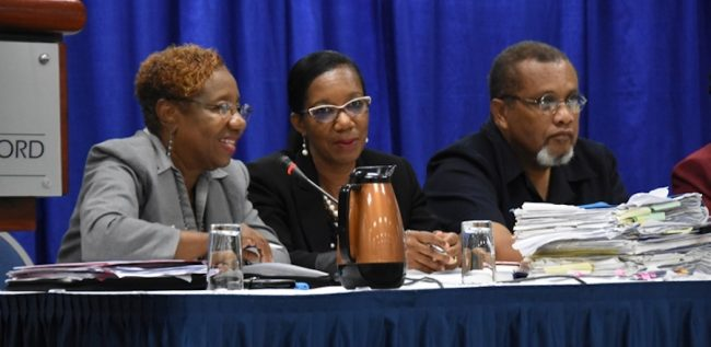 Acting Head of the Civil Service Sonja Welch (left); in discussion with Acting Deputy Permanent Secretary in the Ministry of Finance Betty Alleyne-Headley. Also pictured is Acting Director of Finance and Economic Affairs Dr Louis Woodroffe.
