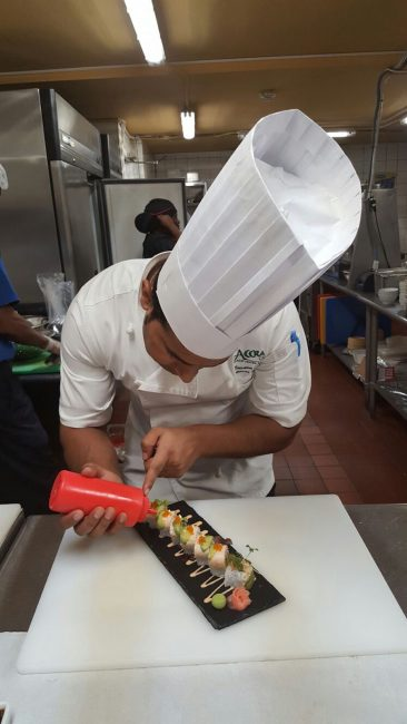 Executive chef at Accra Hotel Abunasar Siddiqui showing off his culinary skills.