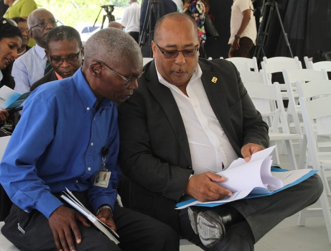 Here, Acting BWA General Manager Dr John Mwansa (left) is pictured with  Minister of Water Resources Management Dr David Estwick.