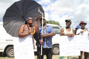 Some of the residents of St Joseph protesting this morning outside the  BWA's headquarters over perennial water outages and high bills.