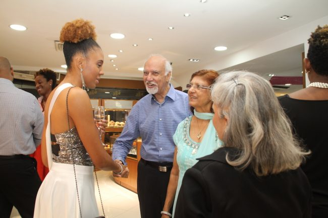 Miss Universe delegate Anique Herbert greeting some of the invited guests.