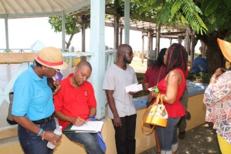 Members of the Small Business Association mingling in Speightstown.