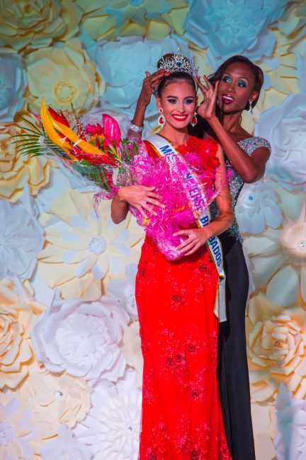 The new Miss Universe Barbados Shannon Harris being crowned by former Miss Universe Barbados Jewel Garner.