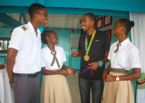 Two-time Olympic champion Christian Taylor (second right) interacting with students from Christ Church Foundation School today. (Picture by Morissa Lindsay)