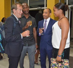 (From left) Featured conference presenter Terry Orlick, conference presenter Paul Sealy, father of Meagan Best, Michael Best, and Caribbean squash champion, Meagan Best, enjoy a light moment.