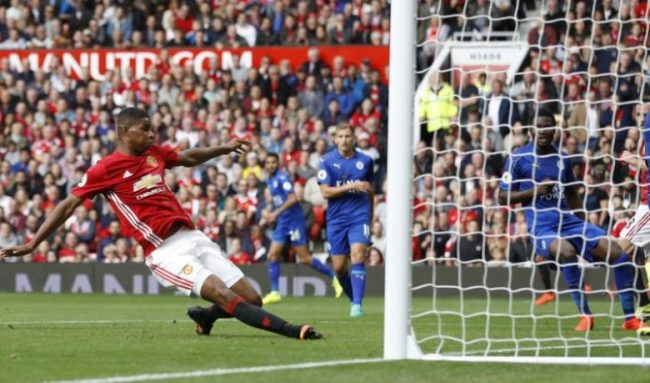 """Britain Football Soccer - Manchester United v Leicester City - Premier League - Old Trafford - 24/9/16 Manchester United's Marcus Rashford scores their third goal Action Images via Reuters / Carl Recine Livepic EDITORIAL USE ONLY. No use with unauthorized audio, video, data, fixture lists, club/league logos or """"live"""" services. Online in-match use limited to 45 images, no video emulation. No use in betting, games or single club/league/player publications. Please contact your account representative for further details."""