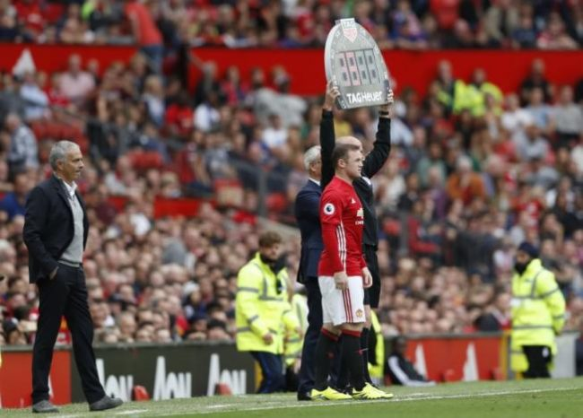 "Britain Football Soccer - Manchester United v Leicester City - Premier League - Old Trafford - 24/9/16 Manchester United's Wayne Rooney comes on as a substitute as Manchester United manager Jose Mourinho looks on Action Images via Reuters / Carl Recine Livepic EDITORIAL USE ONLY. No use with unauthorized audio, video, data, fixture lists, club/league logos or ""live"" services. Online in-match use limited to 45 images, no video emulation. No use in betting, games or single club/league/player publications. Please contact your account representative for further details."