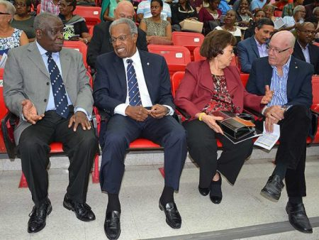From left: Chief Justice Sir Marston Gibson chats with featured speaker and Chancellor of UWI, Sir George Alleyne, while the chancellor's wife, Sylvan Lady Alleyne engages professor emeritus Sir Henry Fraser in conversation before the lecture.