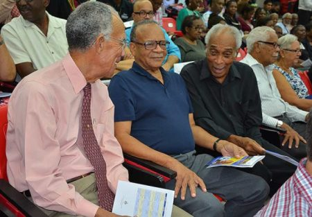 From left: Dr Trevor Hassel, Dr Jean Holder and Dr Errol 'Mickey' Walrond share a light moment before the lecture.